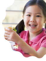 cute little girl eating sandwich